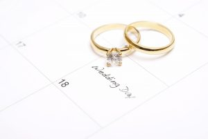 A note on a calendar sets a reminder for the wedding day.